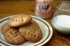 home made peanut butter cookies with small vintage milk bottle and glass of milk