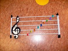 """Add Braille to this tactile music staff for early music education! https://nfb.org/images/nfb/publications/fr/fr18/issue1/f180105.htm """"Helping Blind Music Students"""". Some great pre-braille ideas."""
