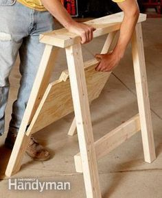 The lip on the shelf holds the sawhorse rigid. To break down the sawhorse, simply lift the shelf. #woodworkingtools #woodworkingtips