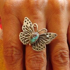 A delicate, lovely and finely tooled butterfly ring, with silver wings and a thorax of Bisbee turquoise . . . the sweetest little butterfly to land on your finger ever.