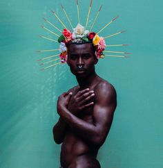 SUBMISSION: Featured Artist- Lynette Luna @lynetteletigre Artist Statement- Black Men with Flowers In society black men have often had to become hyper masculine to deal with the intense pressures projected onto them by society. When we look into the general opinion of black men we think of them as very hard calloused and tough. We do not allow them to be projected in ways of weakness or softness. I photographed a black male with flowers to show a side that is often ignored by society…