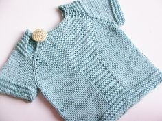 I can never say no to a cute baby sweater with garter and a button. Does this come in an adult size?