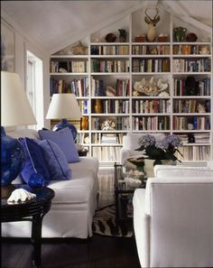 Blue & white library. Love the zebra rug!
