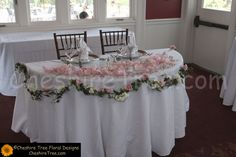 !dupcak-11-whitby castle-rye-wedding-flowers-sweetheart-table-centerpiece-pink-roses-stock-garland-petals-strings-pearls-table-view
