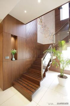 Penthouse Apartment Where Exquisite Art Meets Contemporary Architecture | K.N.Associates - The Architects Diary Staircase Glass Design, Wooden Partition Design, Wooden Staircase Railing, Staircase Interior Design, Wooden Wall Design, Staircase Wall Decor, Home Stairs Design, Bedroom False Ceiling Design, Glass Railing