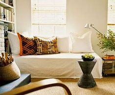 Idea for the loft: Under Cover. The living room sofa is actually a twin bed draped with a canvas drop cloth that can instantly shift into a guest bed. Oversized pillows form the back of the sofa. Twin Bed Couch, Sofa Couch, Twin Beds, Living Pequeños, Living Room Sofa, Small Living, Living Rooms, Living Spaces, Bed Drapes