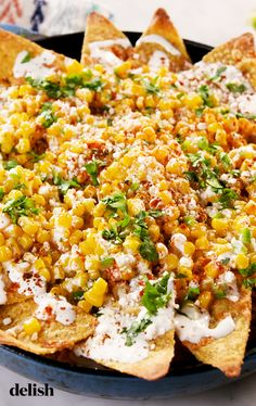 Corn Nachos Street Corn Nachos from are addictively corny.Street Corn Nachos from are addictively corny. Healthy Recipes, Mexican Food Recipes, Vegetarian Recipes, Cooking Recipes, Nacho Recipes, Mexican Dishes, Best Food Recipes, Recipe For Mexican Corn, Healthy Tasty Food