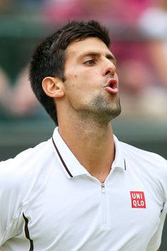 Novak Djokovic of Serbia reacts during the Gentlemen's Singles quarter-final match against Tomas Berdych of Czech Republic on day nine of the Wimbledon Lawn Tennis Championships at the All England Lawn Tennis and Croquet Club at Wimbledon on July 3, 2013 in London, England.