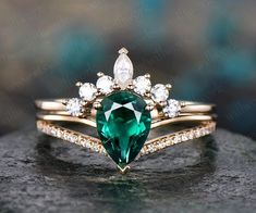 Emerald ring - The main stone is a Pear cut Lab treated emerald. The accent stones are natural conflict free diamonds,SI-H Clarity and Color. The matching band stones are charles colvard moissanites. The material is solid gold ring. Emerald Ring Vintage, Vintage Rings, Gold Diamond Wedding Band, Gold Diamond Rings, Emerald Ring White Gold, Gold Ring, Engagement Ring Settings, Engagement Rings, Morganite Engagement