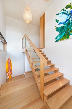 ... glass stair railing Staircase Modern with staircase lighting large artwork ...