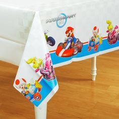 "Mario Kart Wii Printed Tablecover Includes: (1) themed 54"" x 108"" plastic…"