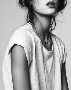 Tee, rolled sleeves with layered jewelry. Nice pose/angle & cropping