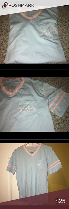 "💘NEW Women's Lauren James Pocket Tee Size M 💘 💘NEW Women's Medium Baby Blue/Pink V-neck Tee. Never worn. SuperComfy & Loose fit. Will update My pics of tee, it doesn't show actual color it's way better & It's So Pretty! I'd say last pic shows true color.  From a Smoke/Pet Free Home💘 Laid flat, total Length: 28"" & Bust across: 20.5-21"" Lauren James Tops Tees - Short Sleeve"
