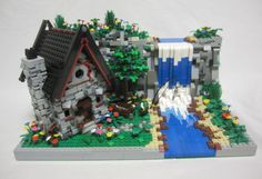 CUSTOM BUILT LEGO CABIN ON MOUNTAIN SIDE WITH WATERFALL AWESOME BUILD MUST SEE