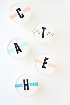Easy monogrammed party favors - these are takeout containers monogrammed using stick on letters and sealed with Washi tape.  Cute!
