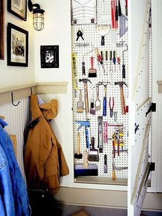 Love this idea ... create a shallow vertical toolbox between wall studs in the mudroom. Add pegboard to hang tools, and a barn-style door to hide it all! It even locks to keep the kids out! 11 mudroom organization tips | Living the Country Life | http://www.livingthecountrylife.com/homes-acreages/country-homes/11-mudroom-organization-tips/