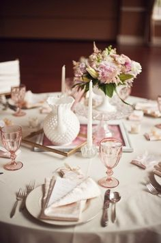 Wedding table centrepiece using vintage clear cake stands (rental price $20-30) & milk glass compotes ($10-20)
