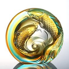 This art piece and glass paperweight symbolizes yin yang harmony and the bond of two. Two fish swim alongside each other, together yet not too close�complimenting each other�s existence. The line of vision is directed to the center, where waves conclude the piece�s statement on harmony and the yin yang balance. A perfect piece for couples or friends.�OFFICIAL INTRO.:RIVER, STEAM, LAKE AND SEA????, ???????�ARTIST DESCRIPTION:An Unfettered PairSwim through emerald waters and Drink from the…