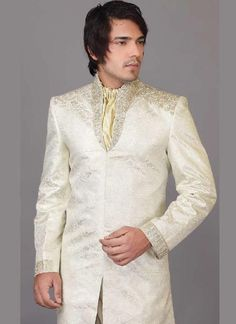 Get most elegant sherwani from the unique collection of Sherwani for Groom. This has sizzling embroidery design on the sherwani. With our white sherwani you will also get golden colored sherwani neck. This is perfect choice for wedding; men would love to have one in their wardrobe. Order us now and have them delivered right at your home with our expedited shipping world wide.  Instead Of $300 You can get this Sherwani in $240.  For any queries email us at support@mensweddingsherwanis.com