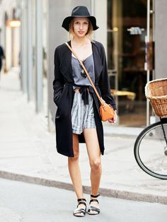 Style a silky trench coat over a camisole and striped shorts, and accessorize with easy separates like a floppy fedora, cross-body bag, and flat sandals.