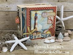 """Down by the Sea Mini Album By Donna Kauffman for Graphic 45  """"I am sharing a full minibook video tutorial today, teaching you how to make a complete 6.5"""" x 6.5"""" File Folder Mini foundation. I decorated mine using G45's beautiful By the Sea Deluxe Collector's Edition collection!  Fun tip!  Use the chipboard pieces as """"charms"""" for a fun spine dangle. Cover the backs of the chipboard pieces with leftover scraps from your project."""" Handmade Scrapbook, Memory Album, Memory Books, Mini Album Tutorial, Graphic 45, Mini Books, Pattern Paper, Mini Albums, Paper Crafts"""