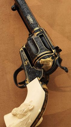 "2006 CCA ""Louisville Gun"" Engraved by Mike Dubber. It won 2009 FEGA Best Engraved Hand Gun"