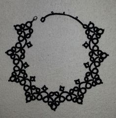 Black thread and a vintage pattern with minor design changes = goth inspired necklace for sale. contact e.b.erikssons@gmail.com