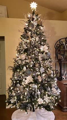 stunning christmas tree with silver and white ornaments and decor want to use a black tree with this decor - Black And Silver Christmas Tree