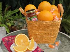 Sweet Spring Basket | Citrus in Yellow Tote, filled with sweet Oranges, Orange Marmalade and Sweet Shop Orange Slice Candies - Hale Groves #spring #basket #oranges |