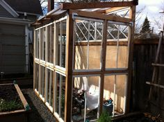 Garden - Recycled Window Greenhouse - doesn& have to be large and can use the fence . Window Greenhouse, Small Greenhouse, Greenhouse Plans, Greenhouse Gardening, Greenhouse Wedding, Recycled Door, Recycled Windows, Old Windows, Windows And Doors