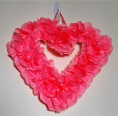 Simple valentine wreath from flower petals from dollar treeand foam board- even kids can do