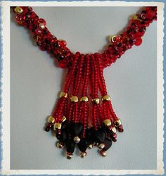 Vibrant Red Glass Heart Spiral Rope Beadwoven Neckace   ~Red Necklace~Heart Necklace~Beadwoven Necklace~Spiral Rope Necklace~Beaded Necklace by simplybeadedtreasure. Explore more products on http://simplybeadedtreasure.etsy.com