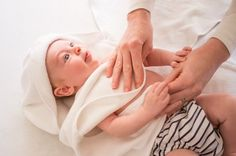 Snow Angel Cushioned Baby Bath Towel: The safe, comfy, and quick way to dry your baby!   *Padded back panel protects baby from hard surfaces *Adjustable-length hood grows with your baby *Soft terry-velour wings allow for easy drying of arms and legs / Strategically designed to safely and easily reach and dry arms, legs, and all the bits in between.   *100% Cotton (exterior terry/velour) + 100% Polyester (interior cushion) *Safe for the washing machine and dryer.