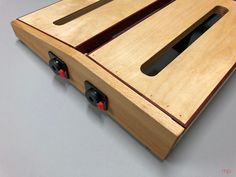 My diy pedalboard for uke: beech sides and baltic birch top trimmed in paduak. Donner power supply mounted on underside.