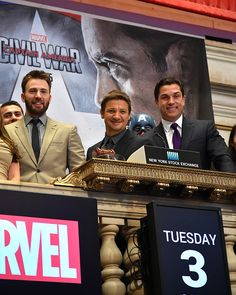 Actors Chris Evans and Jeremy Renner with President of the NYSE Tom Farley ring The New York Stock Exchange Opening Bell To Promote Release Of...