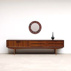 1960s OSWALD VERMAERCKE ULTRA LOW V-FORM 'PAOLA' SIDEBOARD Here's a ultra low credenza 'Paola' designed by Oswald Vermaercke for V-form. This Belgium production was created first in 1959 and was named to the Belgium queen who was married at the time to King Albert. There is remarkable Danish influence in the Paola line. The design is minimalist and simple. The structure is functional and decorative.