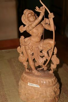 Rama with the bow, crafted from a single block of Sandalwood, the bow string stands unbroken throughout the crafting. This won Mani the State award for the sculpture.