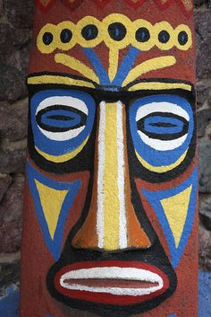 A close up of the tiki face outside the main entrance of the Kon Tiki in Tucson, Arizona. Arte Tribal, Tribal Art, Tiki Faces, Palm Frond Art, Tiki Man, Hawaiian Party Decorations, Kerala Mural Painting, Painted Flower Pots, Tiki Party