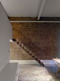 Bell Phillips installs folded steel staircase inside London apartment
