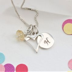 This mini sterling silver open heart pendant necklace can be personalised with letter charms and November birthstone gemstones to celebrate the life of a child. Heart Locket, Heart Pendant Necklace, Gemstone Necklace, Birthstone Charms, Birthstone Necklace, Topaz Jewelry, Jewellery, Letter Charms, Pearl Stud Earrings