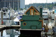 i love houseboats so much, especially teal ones