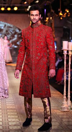 a red sherwani for the groom #indianwedding #manishmalhotra Visit http://www.yourdreamshaadi.co.uk/Wedding-Sherwanis for more inpiration!