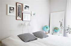 Love the basic arrangement of frames above the bed