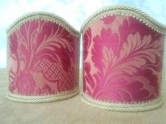 Couple of lampshades decorated with gorgeous damask fabric with floreal patterns in high relief, finished with gold trimmings. € 34,00