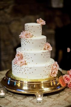 Simple gold accents and blush flowers also gave this four-tier wedding cake an air of elegance and charm.