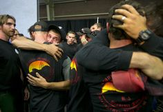 Prescott-area forest firefighters embrace eat the end of a memorial service in Prescott on  July 1, 2013, for the 19 firefighters killed battling the Yarnell Hill Fire.