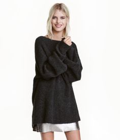 Dark gray melange. Oversized, straight-cut knit sweater in a soft mohair blend. Heavily dropped shoulders, wide, long sleeves, and ribbing at neckline and