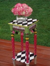 This adorable side table is hand painted in shades of pink, black, white, green, yellow and gold. Add a plant, flowers, candles............it's a show stopper. Perfect for a young ladies personal space or even to accent shabby chic decor.