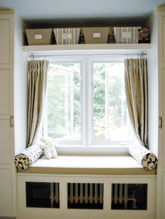 I have always wanted a window seat. Now that I actually have something nice to look out on I *really* want a window seat. This is my inspiration.