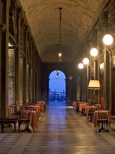 Italy / Venice / Gran Caffe Chioggia, San Marco Square, Venice | You could see the gondolas in the blue twilight of San Marco Basin.... This is one of the oldest historic cafes in Venice, along the San Marco plaza.